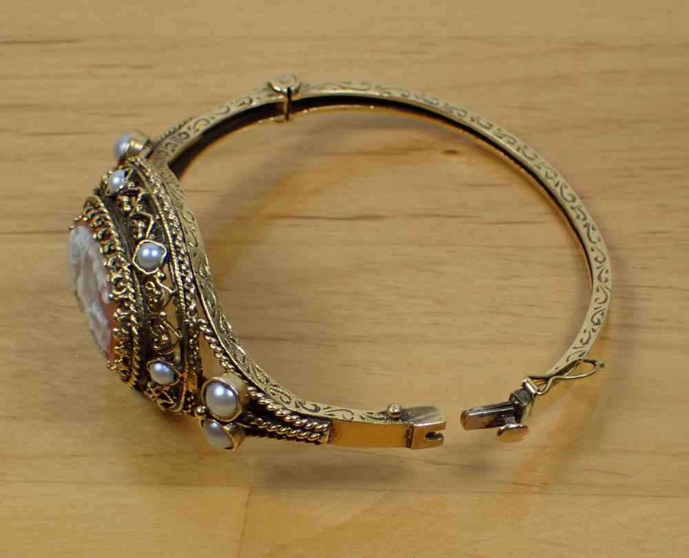CAMEO, PEARL AND FOURTEEN KARAT GOLD BANGLE. The