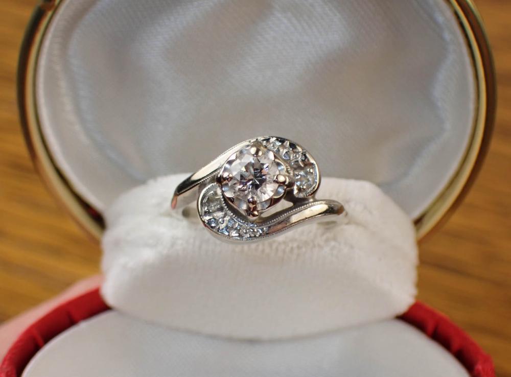 DIAMOND AND FOURTEEN GOLD KARAT WEDDING RING SET