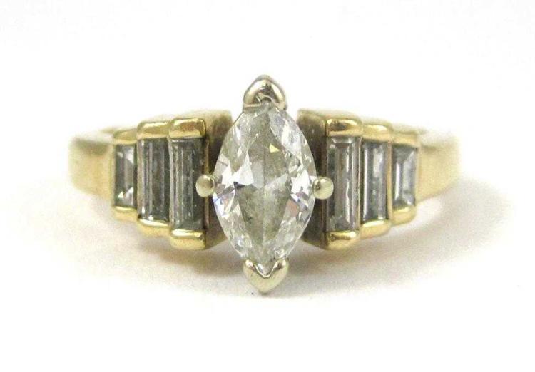 DIAMOND AND FOURTEEN KARAT GOLD RING