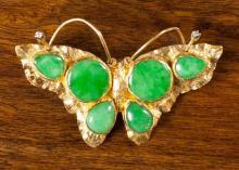 GREEN JADE AND TWENTY-TWO KARAT GOLD BROOCH
