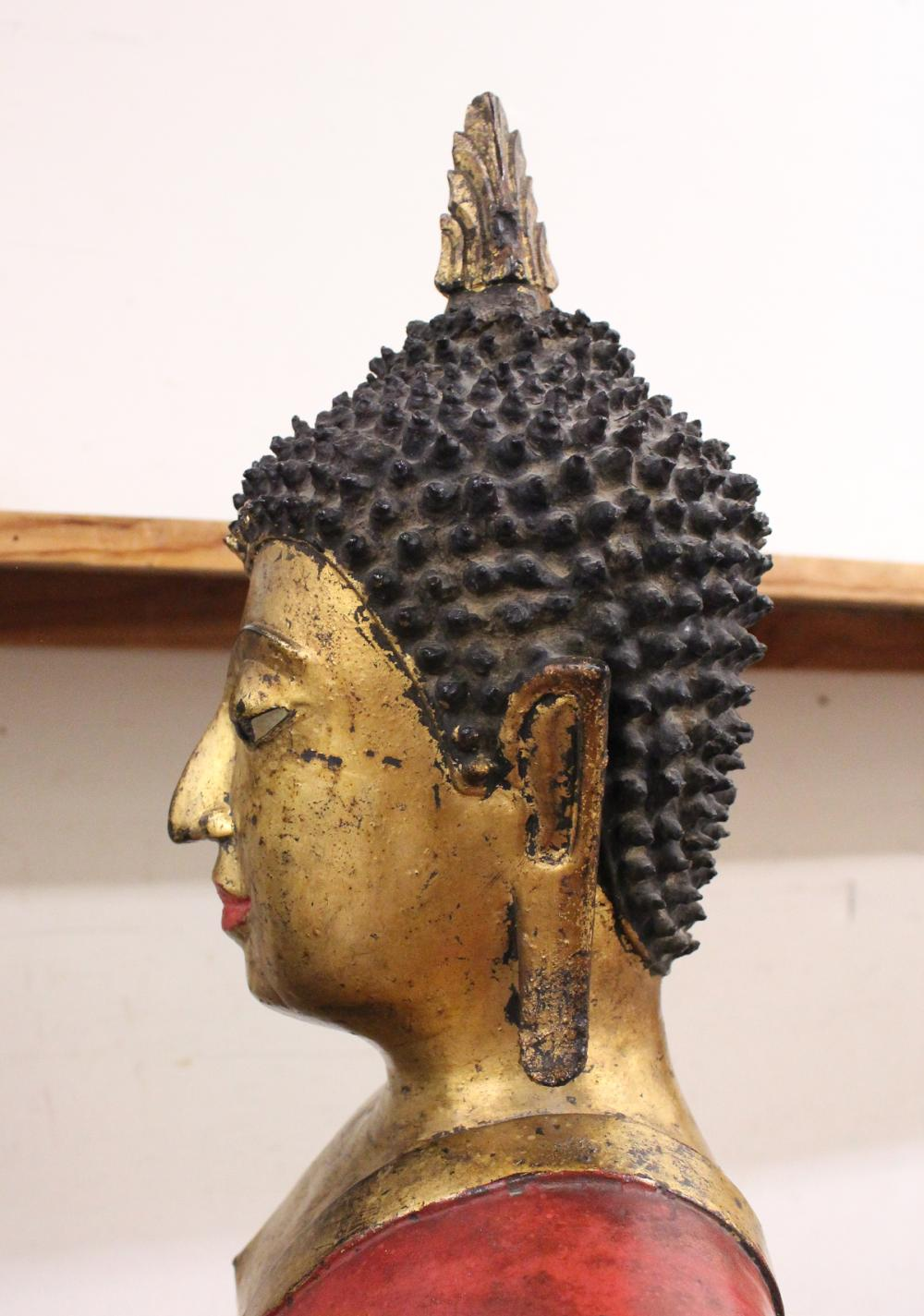 THAI PARCEL GILT AND RED PAINTED BRONZE FIGURE OF BUDDHA
