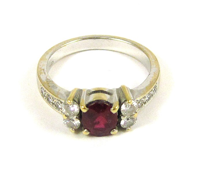 RUBY, DIAMOND AND EIGHTEEN KARAT GOLD RING. The wh