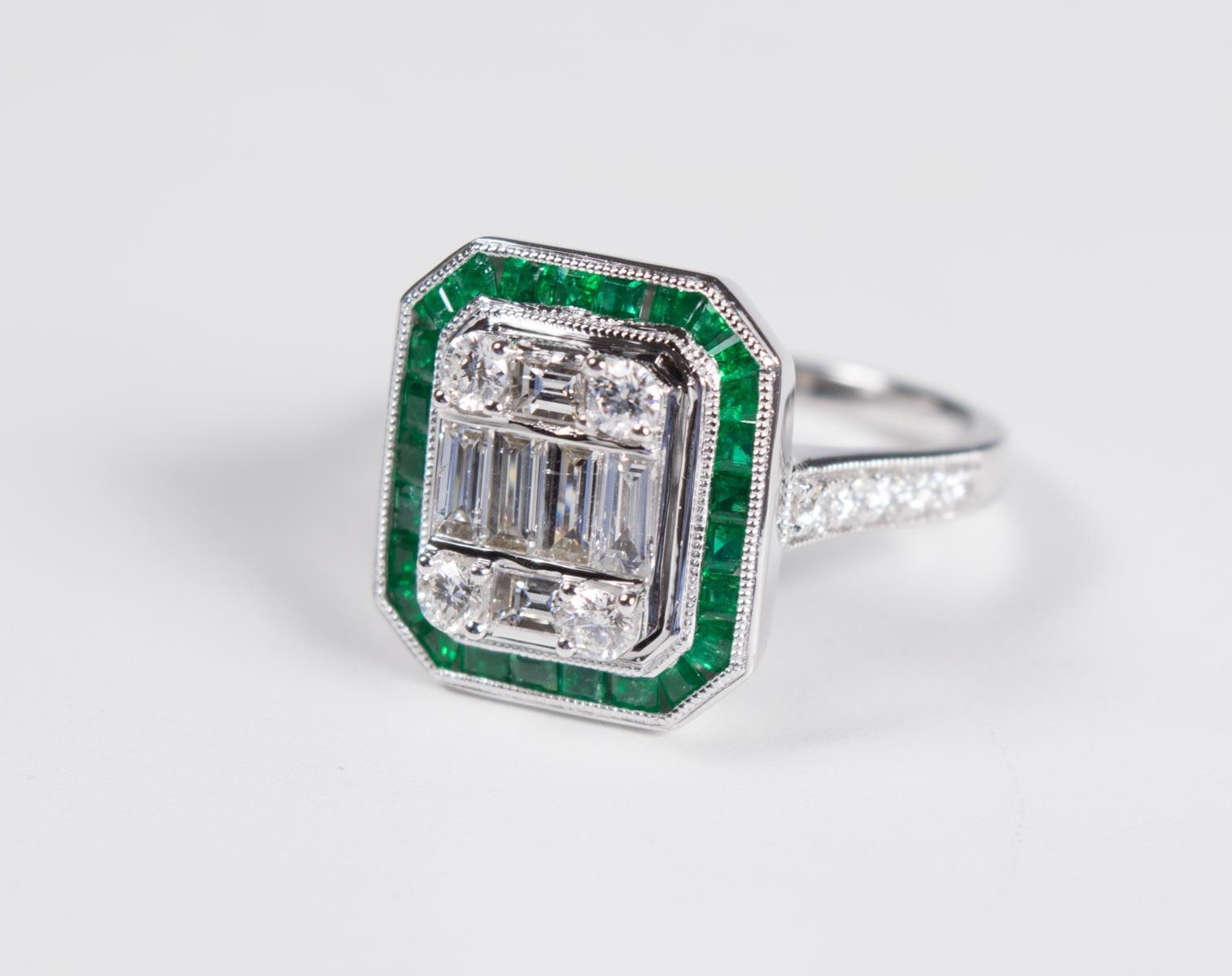 DIAMOND, EMERALD AND EIGHTEEN KARAT WHITE GOLD RIN