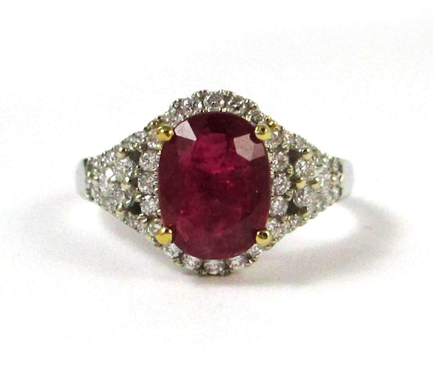 RUBY, DIAMOND AND FOURTEEN KARAT GOLD RING. The 1