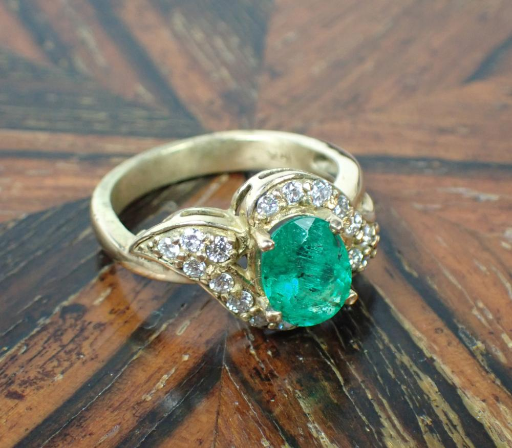 EMERALD, DIAMOND AND FOURTEEN KARAT GOLD RING