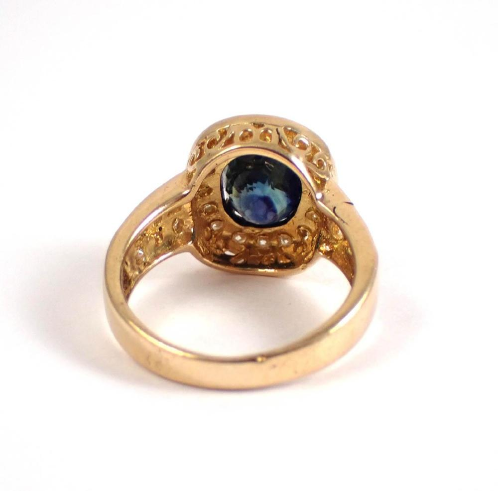 SAPPHIRE, DIAMOND AND FOURTEEN KARAT GOLD RING