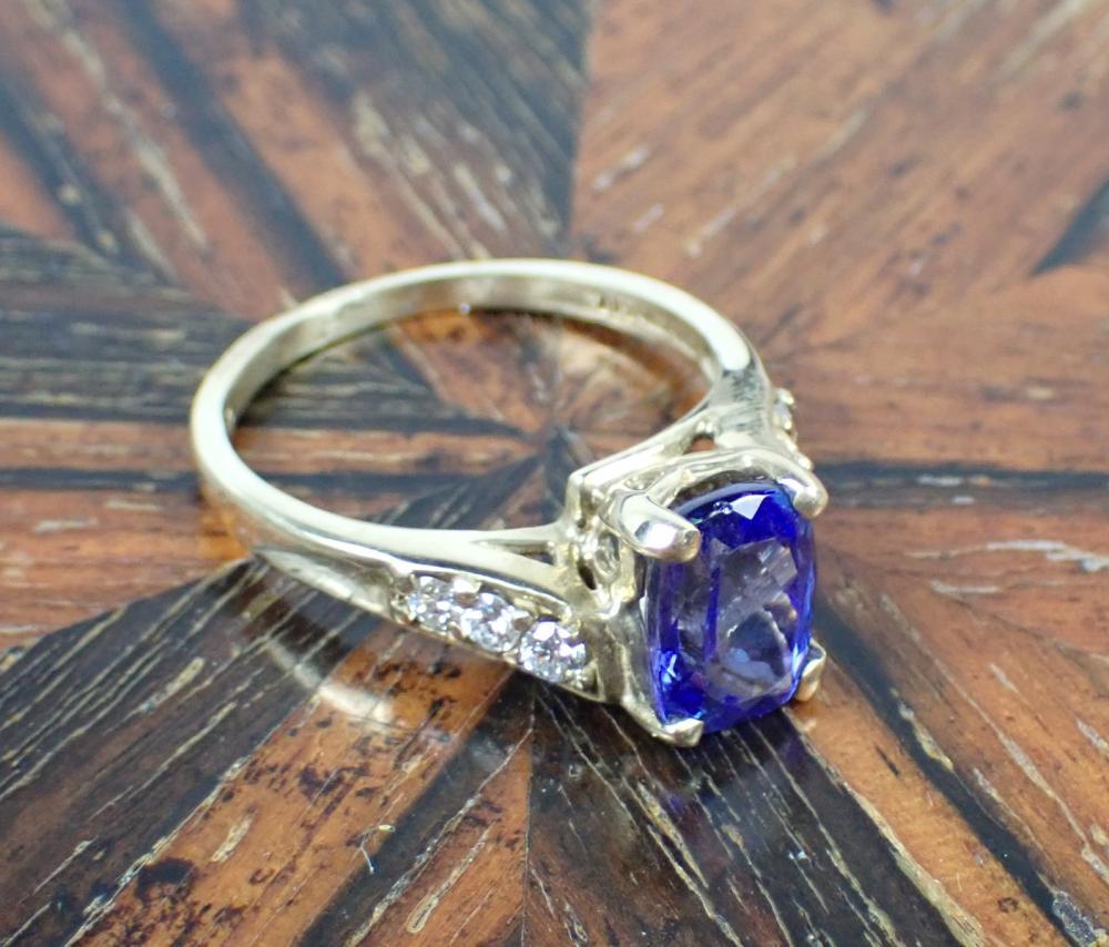 TANZANITE, DIAMOND AND FOURTEEN KARAT GOLD RING