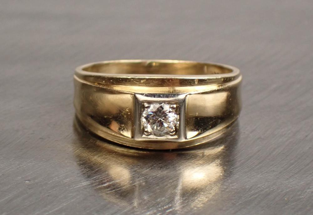 MAN'S DIAMOND AND FOURTEEN KARAT GOLD RING