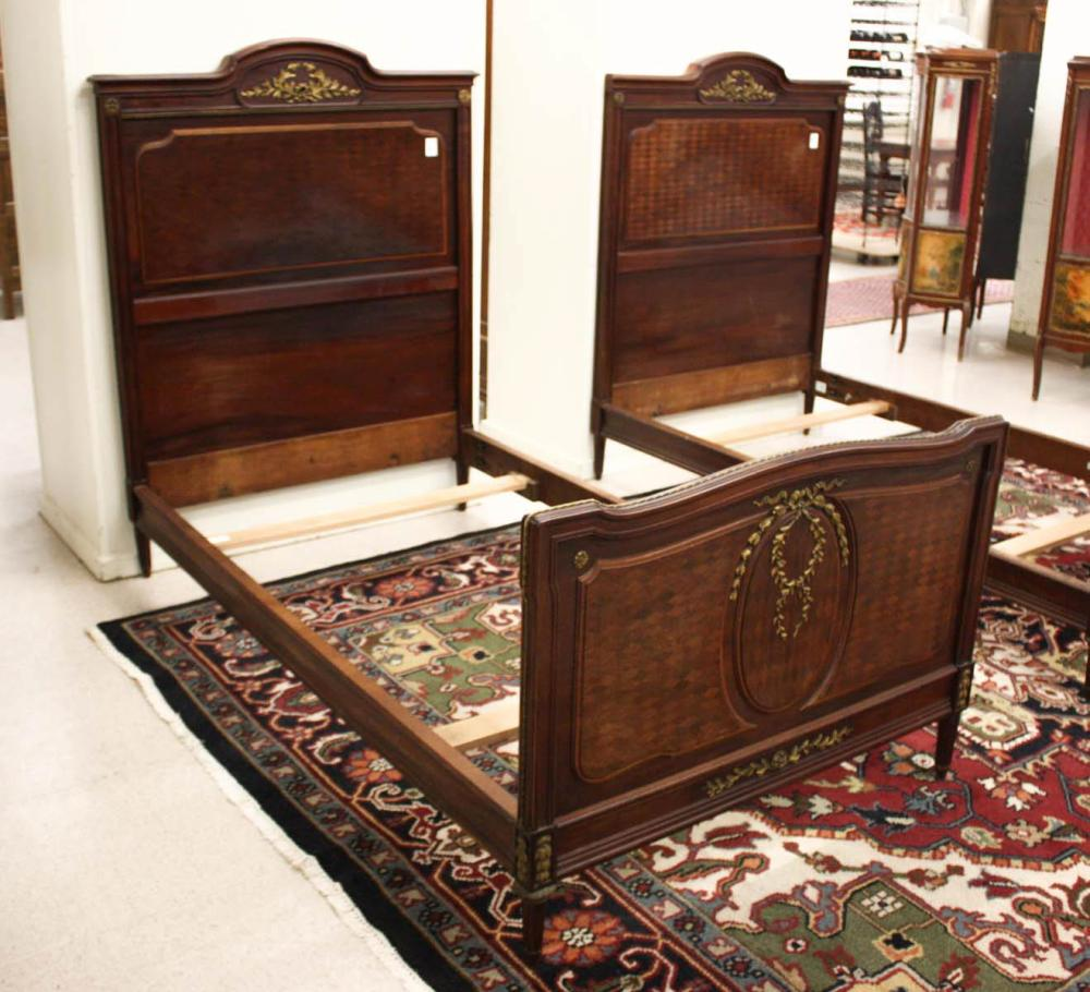 A PAIR OF LOUIS XVI STYLE TWIN BEDS WITH ORIGINAL