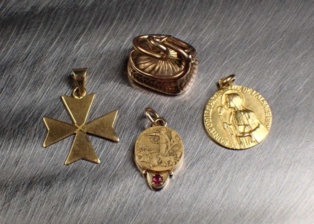 COLLECTION OF FOUR GOLD PENDANT/CHARMS