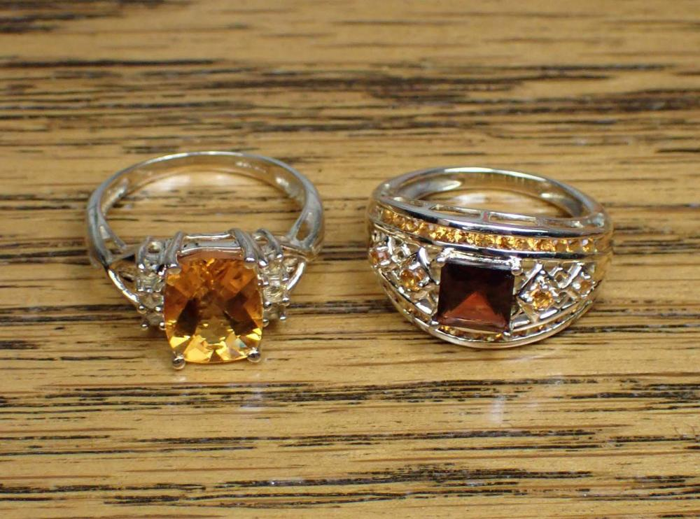 TWO CITRINE AND YELLOW GOLD RINGS
