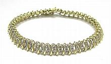 DIAMOND AND FOURTEEN KARAT GOLD BRACELET,