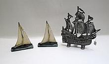 TWO HUBLEY ATTRIBUTED SAIL BOAT DOOR STOPS and one