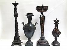 FOUR BRONZE URNS AND CANDLE STANDS, each uniquely