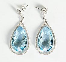 PAIR OF BLUE TOPAZ AND DIAMOND EARRINGS, each 14k