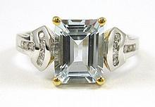 AQUAMARINE, DIAMOND AND FOURTEEN KARAT GOLD RING.