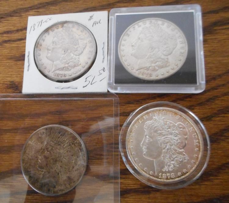 FOUR U.S. SILVER DOLLARS.  Three Morgan type:  187