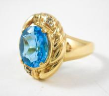 BLUE TOPAZ, DIAMOND AND TEN KARAT GOLD RING, with