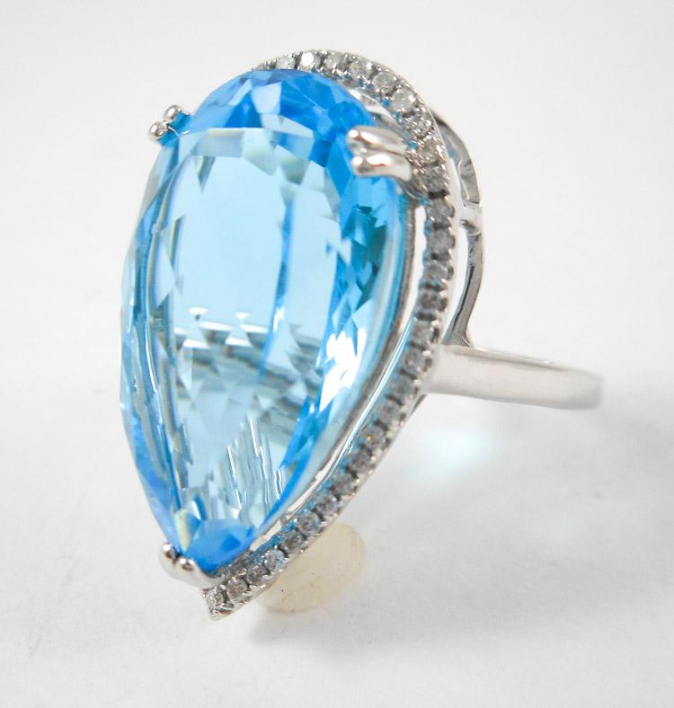 BLUE TOPAZ, DIAMOND AND FOURTEEN KARAT GOLD RING.