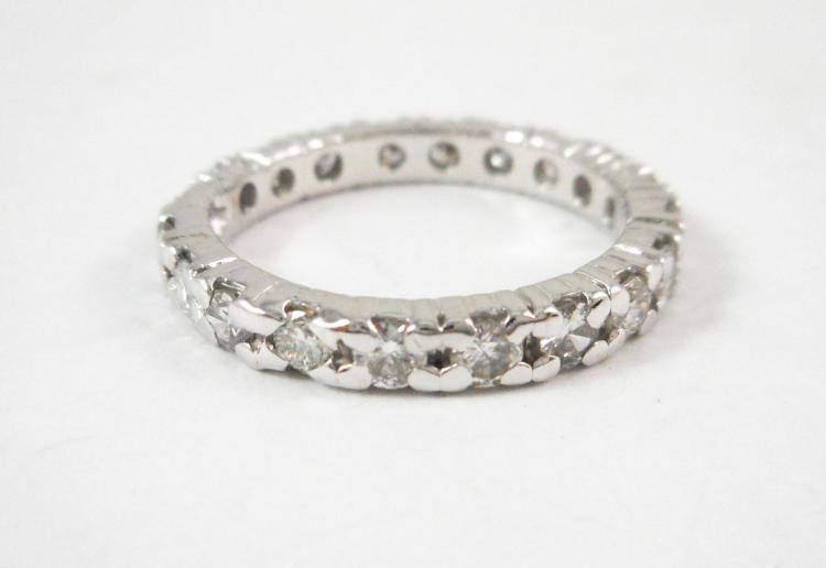 DIAMOND AND FOURTEEN KARAT GOLD ETERNITY RING. Th