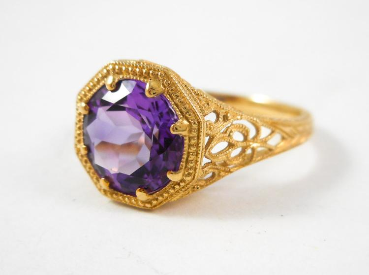AMETHYST AND FOURTEEN KARAT GOLD SOLITAIRE RING.