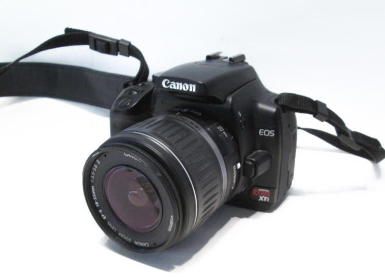 CANON EOS DIGITAL REBEL SLR CAMERA includes:  EF-S