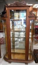 AN OAK AND CURVED GLASS CHINA DISPLAY CABINET, Ame