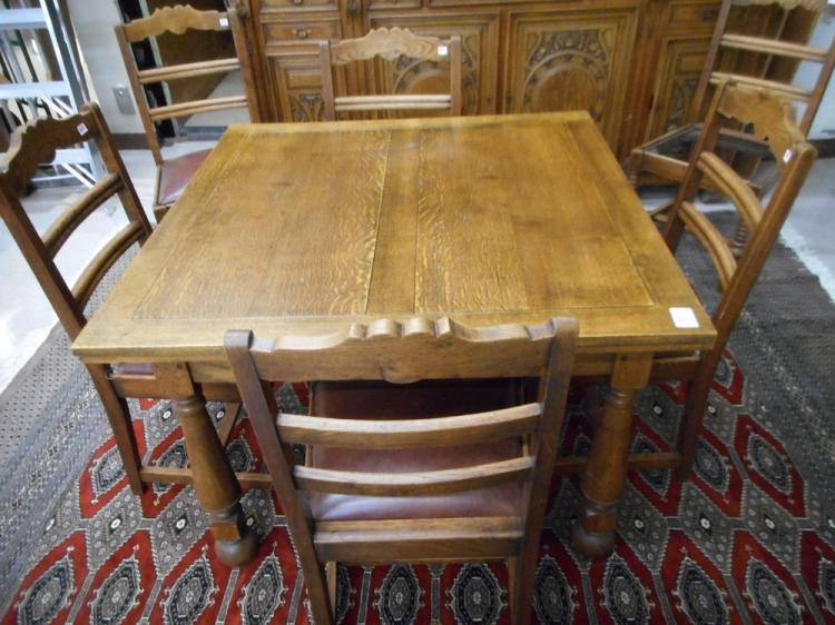 AN OAK DINING TABLE AND A SET OF SIX CHAIRS, Engli