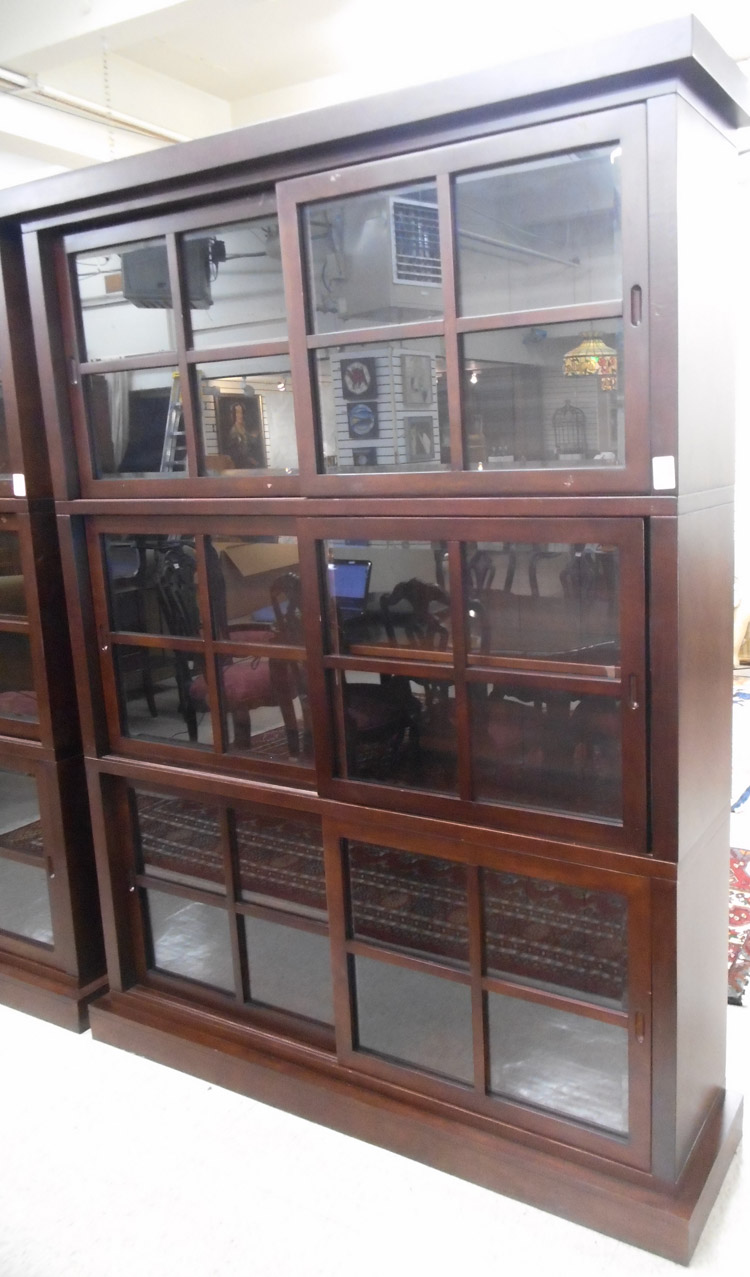 CONTEMPORARY THREE SECTION CABINET BOOKCASE, each