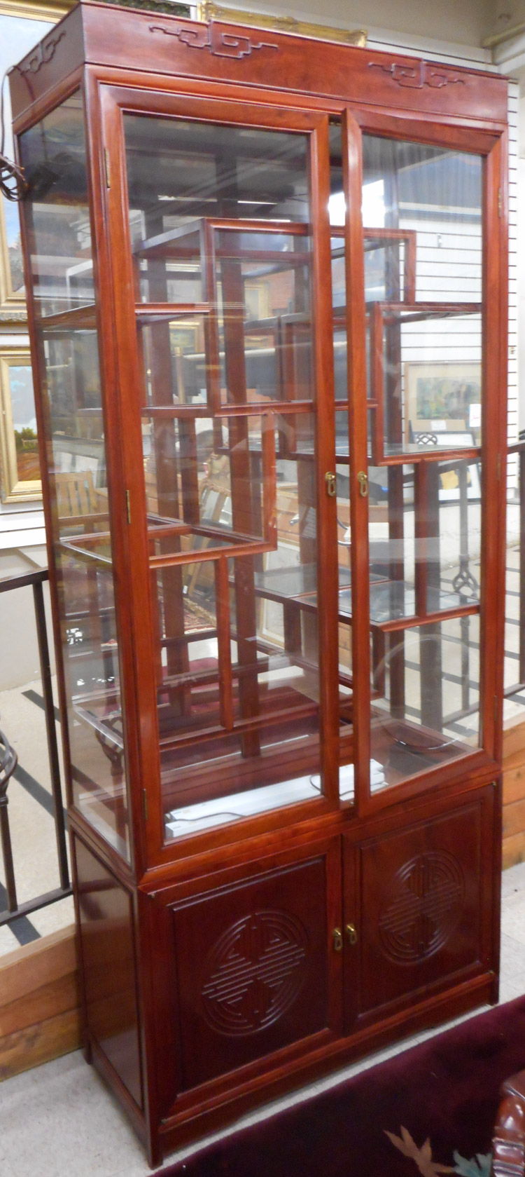 CHINESE ROSEWOOD AND GLASS CURIO CABINET ON CABINE