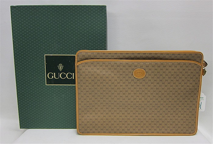 GUCCI CANVAS BRIEFCASE, embossed with the Gucci