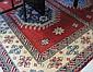 HAND KNOTTED ORIENTAL CARPET, Indo-Kazak, three