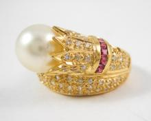 PEARL, RUBY, DIAMOND AND YELLOW GOLD RING.  The 14