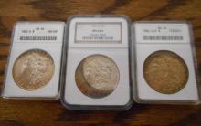 THREE U.S. SILVER MORGAN DOLLARS:  1883-O, ANACS g