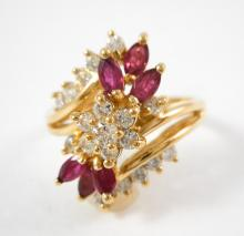 RUBY, DIAMOND AND FOURTEEN KARAT GOLD RING.  The y
