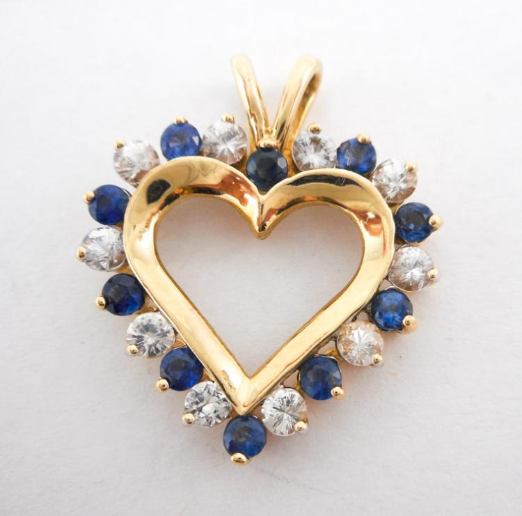 BLUE AND WHITE SAPPHIRE HEART PENDANT.  The 10k ye