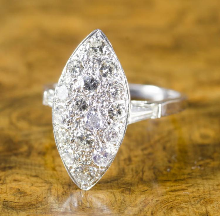 DIAMOND AND PLATINUM RING, a tapered baguette diam