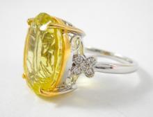 LEMON TOPAZ, DIAMOND AND FOURTEEN KARAT GOLD RING.