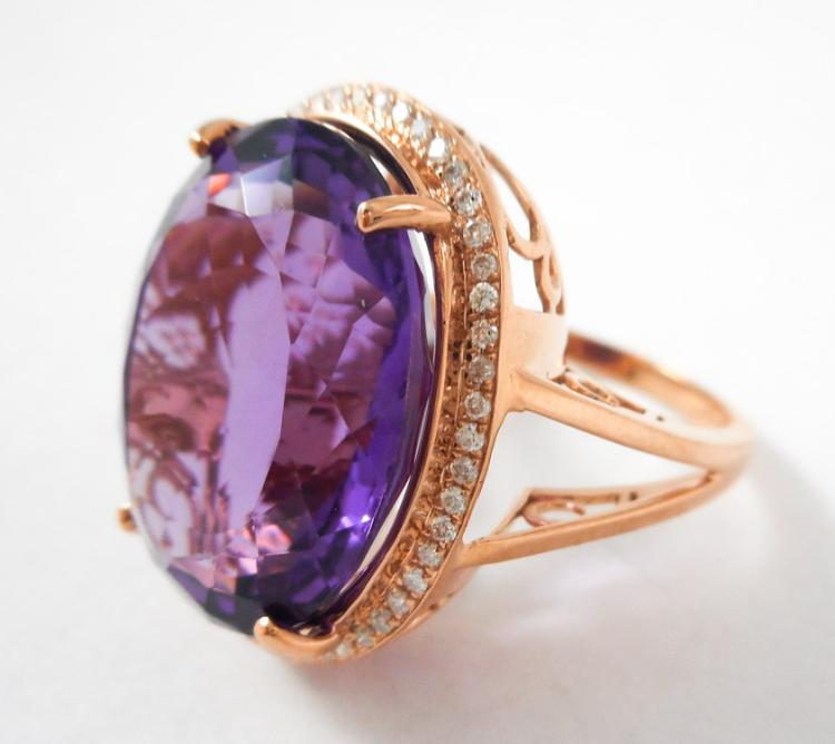 AMETHYST, DIAMOND AND FOURTEEN KARAT GOLD RING. T