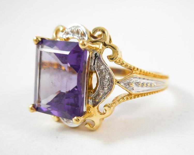AMETHYST, DIAMOND AND TEN KARAT GOLD RING. The ye