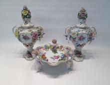 PAIR OF DRESDEN FIGURAL PORCELAIN URNS AND FOOTED