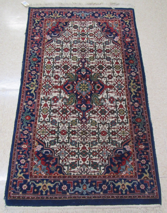A CONTEMPORARY PERSIAN AREA RUG, central floral cr