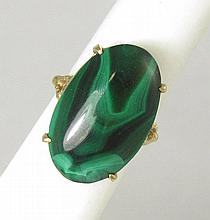MALACHITE AND FOURTEEN KARAT GOLD RING, with four