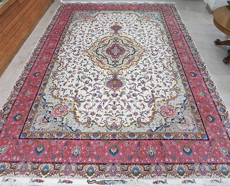 A CONTEMPORARY PERSIAN WOOL AND SILK CARPET, color
