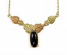 BLACK HILLS GOLD NECKLACE. The 10k tri-color gold