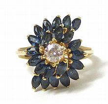 SAPPHIRE, DIAMOND AND FOURTEEN KARAT GOLD RING,