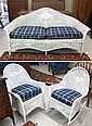 THREE-PIECE WHITE WICKER SEATING FURNITURE SET,  American, early 20th century, the set comprising sofa. rocking chair and armchair.  Sofa length - 69 inches.