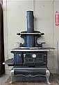 ANTIQUE CAST IRON WOOD-FIRE COOK STOVE,
