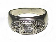 MAN'S DIAMOND AND FOURTEEN KARAT WHITE GOLD RING,