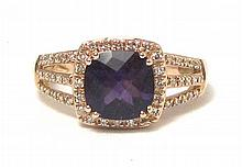 AMETHYST, DIAMOND AND FOURTEEN KARAT GOLD RING.